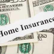 Home Insurance written over US money