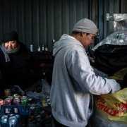 Man going through trash in homeless shelter
