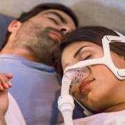 Man and woman with CPAP sleeping