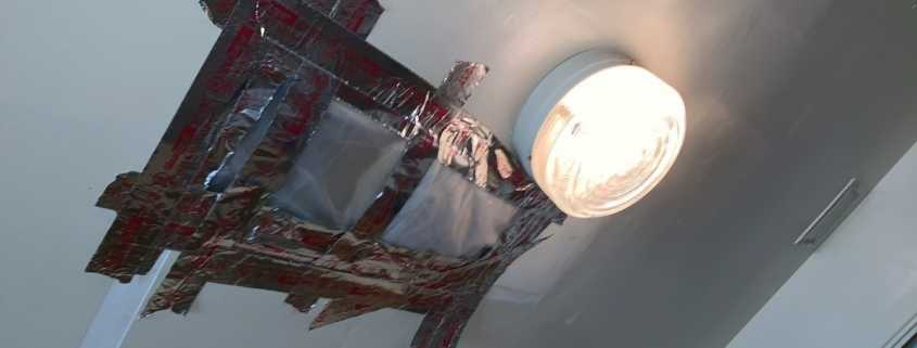 Patched ceiling from mold in military housing