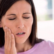 Woman with dental pain from mold
